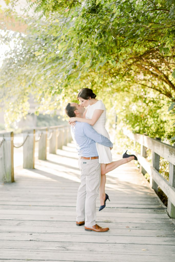Couple Engagement Photo kissing in air